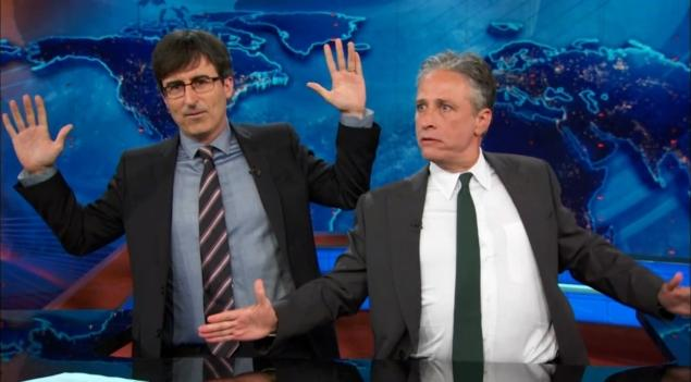 John Oliver (l) and Jon Stewart on the set of The Daily Show