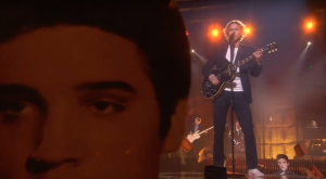 Stand-in Isac Aspberg sings to Elvis Presley audience stand-ins, with a stand-in in the background playing a wooden cutout of a guitar